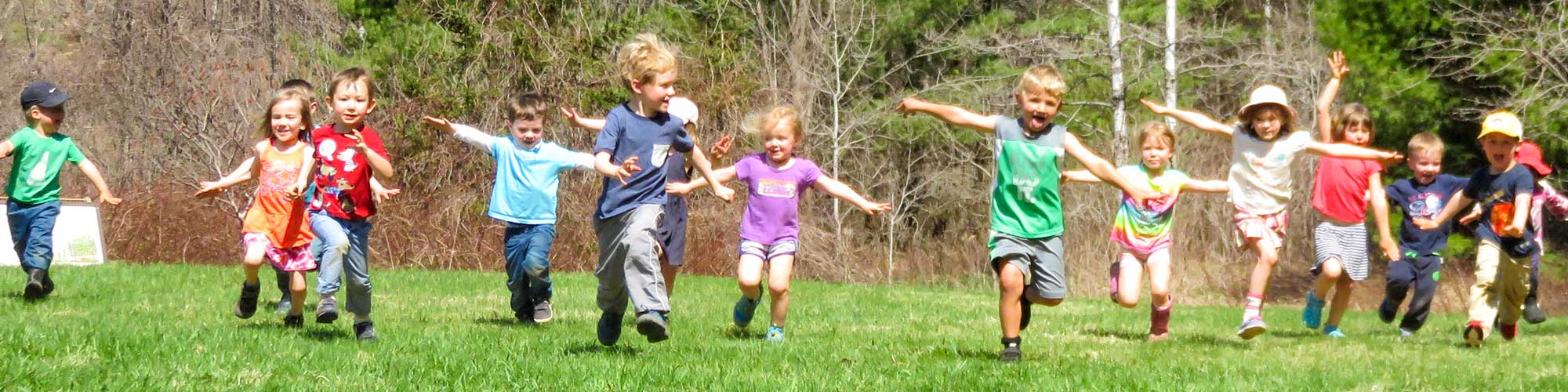 Blue Heron School students running through field