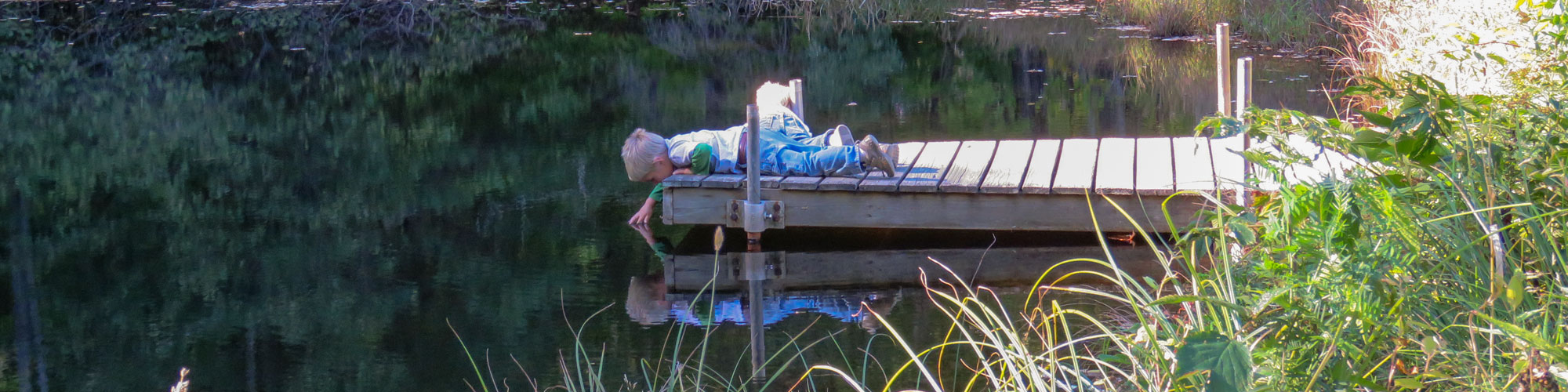 Children laying on dock at Upper Pond