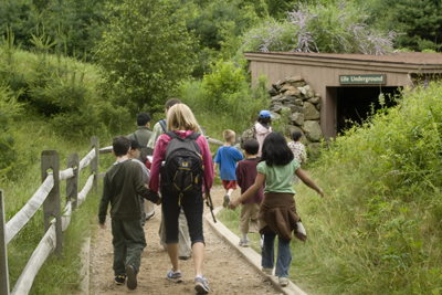 Group walking on Gephart Exhibit Trail